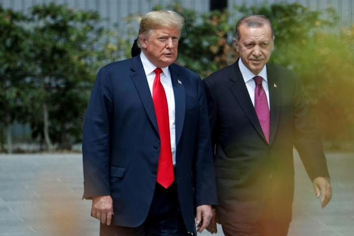 US President Donald Trump strolls with Turkish President Recep Tayyip Erdogan during a July 2018 visit at the NATO headquarters (AFP Photo/GEOFFROY VAN DER HASSELT)