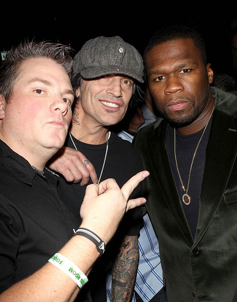 "Tommy Lee was all smiles while hanging with DJ Aero and 50 Cent -- who looked spiffy in his velvet blazer -- at the House of Hype Lifestyle Lounge. Michael Bezjian/<a href=""http://www.wireimage.com"" target=""new"">WireImage.com</a> - January 23, 2011"