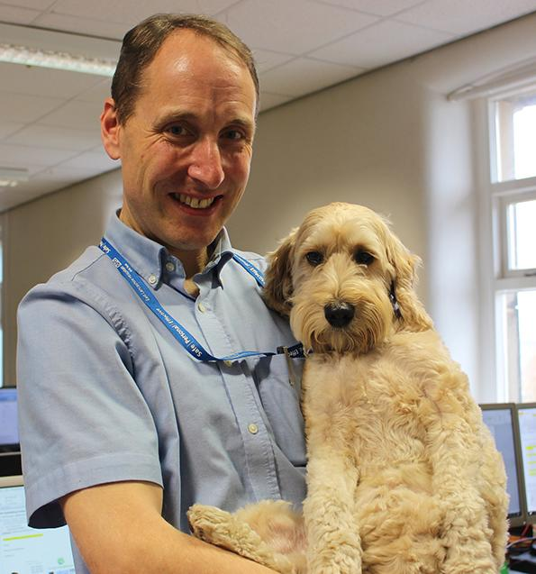 Hospital chaplain David Anderson and therapy dog Jasper