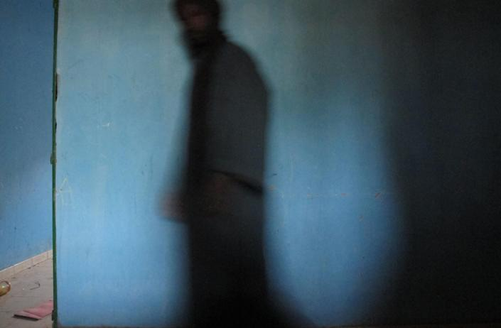 In this Wednesday, Feb. 6, 2013 photo, neighborhood resident Mohamed Alassane walks past a room where he and other residents say al Qaida held European hostages, at the Ministry of Finance's Regional Audit Department, in Timbuktu, Mali. In the same building, occupied by Islamists for more than a year, the AP found a more than 10-page letter signed by Abdelmalek Droukdel, the senior commander appointed by Osama bin Laden to run al-Qaida's branch in Africa. The confidential letter from the terror leader spelled out the terror network's blueprint for conquering this desert nation.(AP Photo/Rukmini Callimachi)
