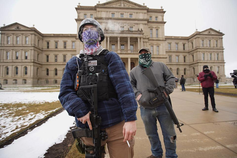 A member of the Boogaloo Bois attends a protest outside of the Michigan State Capitol building in downtown Lansing on Sunday, Jan. 17, 2021.