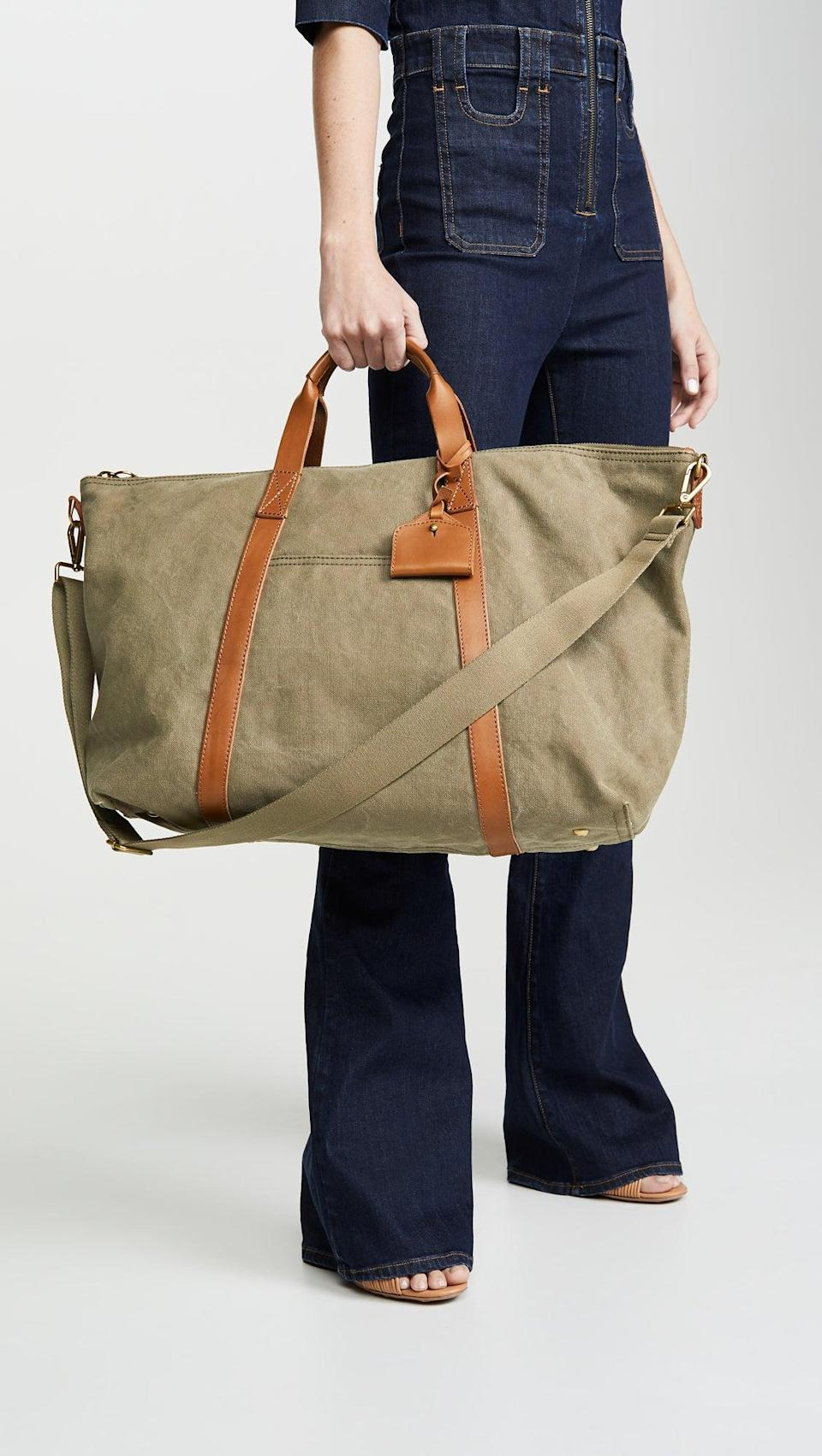 """<h3><a href=""""https://www.madewell.com/the-essential-weekender-bag-99105448613.html"""" rel=""""nofollow noopener"""" target=""""_blank"""" data-ylk=""""slk:Madewell Canvas Overnight Bag"""" class=""""link rapid-noclick-resp"""">Madewell Canvas Overnight Bag</a></h3><br>Madewell's version of a weekender combines a tote with a duffel and dresses it in canvas with leather trim for one stylish, roomy, and tote-worthy travel bag. <br><br><strong>Madewell</strong> Canvas Overnight Bag, $, available at <a href=""""https://go.skimresources.com/?id=30283X879131&url=https%3A%2F%2Fwww.madewell.com%2Fthe-essential-weekender-bag-99105448613.html"""" rel=""""nofollow noopener"""" target=""""_blank"""" data-ylk=""""slk:Madewell"""" class=""""link rapid-noclick-resp"""">Madewell</a>"""
