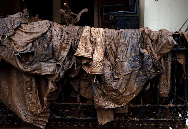 <p>Muddy clothes have been left on a fence of a house in Mandra, Western Attica, Greece, Nov. 16, 2017. (Photo: Yannis Kolesidis/EPA-EFE/REX/Shutterstock) </p>