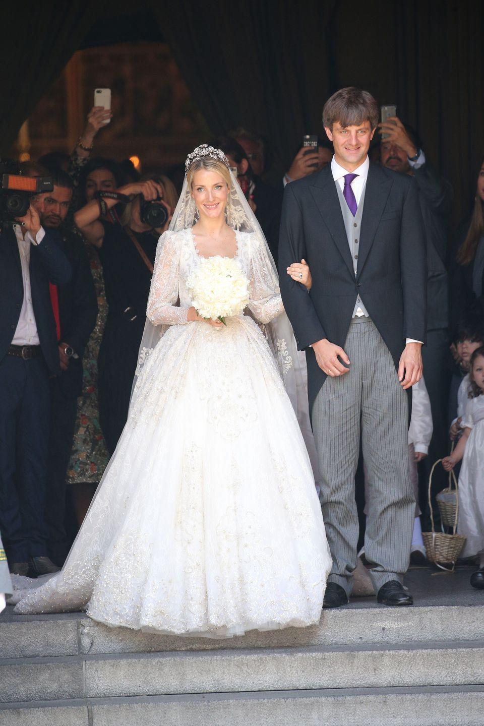 <p>Technically, the German House of Hanover hasn't ruled over a kingdom in <span>over a century</span>; but, Prince Ernst August of Hanover, Jr.'s wedding to Ekaterina Malysheva was still an undoubtedly royal affair. Lebanese designer Sandra Mansour dressed the Russian-born, London-based bride in a gown composed of Chantilly lace, beaded details, and hints of light pink. </p><p>Fun fact: the royal bride happens to be a fashion designer herself. She runs a high-end jumpsuit line called EKAT.</p>