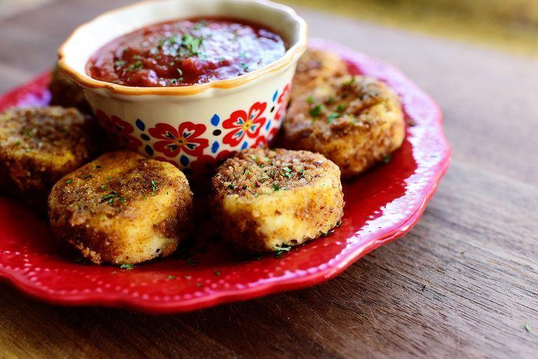 """<p>These fried goat cheese bites are perfect if you're just hanging out with your kids this Christmas. The marinara dipping sauce is key.</p><p><strong><a href=""""https://www.thepioneerwoman.com/food-cooking/recipes/a82562/fried-goat-cheese/"""" rel=""""nofollow noopener"""" target=""""_blank"""" data-ylk=""""slk:Get the recipe."""" class=""""link rapid-noclick-resp"""">Get the recipe.</a></strong></p><p><strong><a class=""""link rapid-noclick-resp"""" href=""""https://go.redirectingat.com?id=74968X1596630&url=https%3A%2F%2Fwww.walmart.com%2Fsearch%2F%3Fquery%3Dpioneer%2Bwoman%2Bdipping%2Bbowls&sref=https%3A%2F%2Fwww.thepioneerwoman.com%2Ffood-cooking%2Fmeals-menus%2Fg34272733%2Fchristmas-party-appetizers%2F"""" rel=""""nofollow noopener"""" target=""""_blank"""" data-ylk=""""slk:SHOP DIP BOWLS"""">SHOP DIP BOWLS</a><br></strong></p>"""