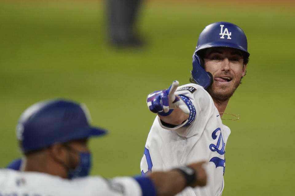 Los Angeles Dodgers' Cody Bellinger celebrates his two-run home run against the Tampa Bay Rays during the fourth inning in Game 1 of the baseball World Series Tuesday, Oct. 20, 2020, in Arlington, Texas. (AP Photo/Eric Gay)