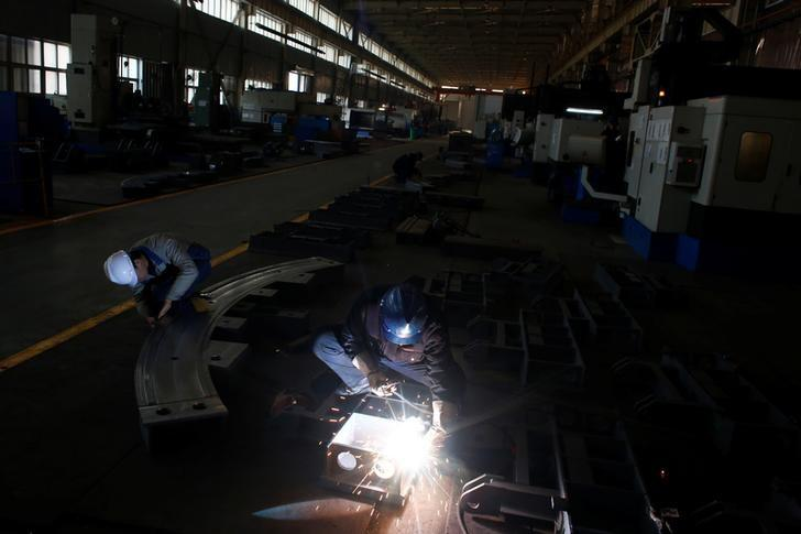 A worker welds in the Tianye Tolian Heavy Industry Co. factory in Qinhuangdao