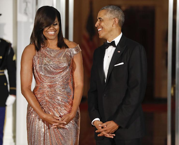 President Barack Obama and first lady Michelle Obama smile together as they wait to greet Italian Prime Minister Matteo Renzi and his wife Agnese Landini on the North Portico for a State Dinner at the White House in Washington, Tuesday, Oct. 18, 2016. (AP Photo/Pablo Martinez Monsivais)