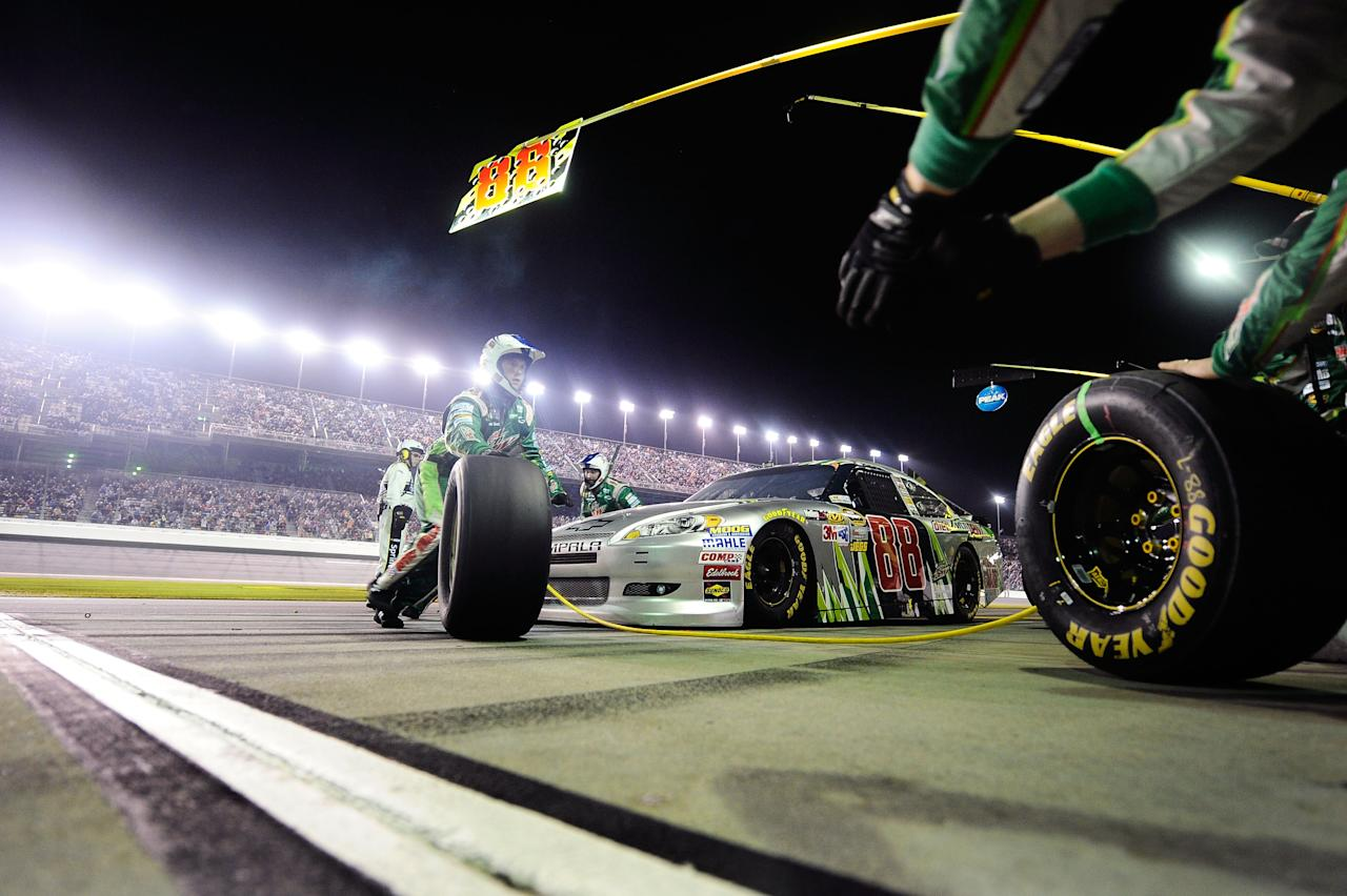 DAYTONA BEACH, FL - FEBRUARY 27:  Dale Earnhardt Jr., driver of the #88 Diet Mountain Dew/National Guard Chevrolet, pits during the NASCAR Sprint Cup Series Daytona 500 at Daytona International Speedway on February 27, 2012 in Daytona Beach, Florida.  (Photo by Jared C. Tilton/Getty Images for NASCAR)