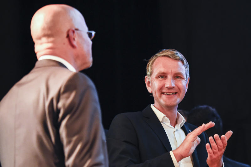 Top candidate of right-wing party Alternative for Germany, AfD, for the elections at the federal state Brandenburg Andreas Kalbitz, left, gets applause from AfD Thuringia chairman Bjoern Hoecke, right,at an election party in Werder, near Potsdam, Sunday, Sept. 1, 2019. The citizens of the German federal states Saxony and Brandenburg elected their new parliament. ( Gregor Fischer/dpa via AP)