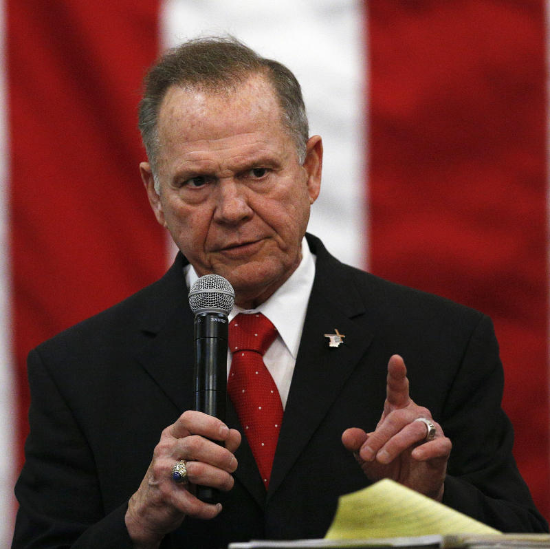Roy Moore, Doug Jones vote in Alabama's Senate election