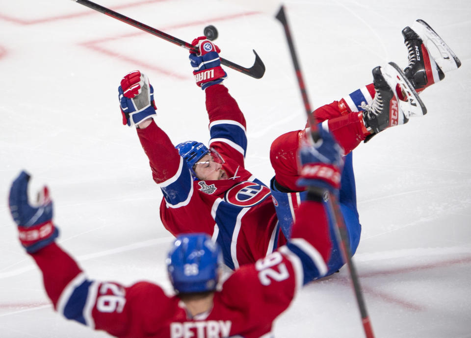 Montreal Canadiens' Josh Anderson (17) slides on the ice while celebrating after scoring the winning goal at the end of overtime of Game 4 of the NHL hockey Stanley Cup final against the Tampa Bay Lightning in Montreal, Monday, July 5, 2021. (Ryan Remiorz/The Canadian Press via AP)