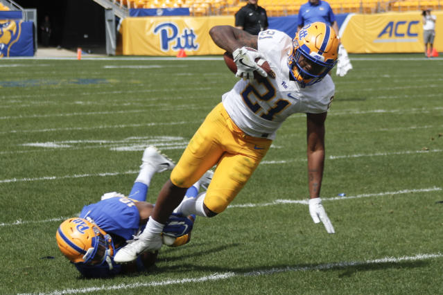 Pittsburgh running back A.J. Davis (21) is tackled by Shocky Jacques-Louis (18) during their annual intrasquad Blue-Gold spring NCAA college football game, Saturday, April 13, 2019, in Pittsburgh. (AP Photo/Keith Srakocic)