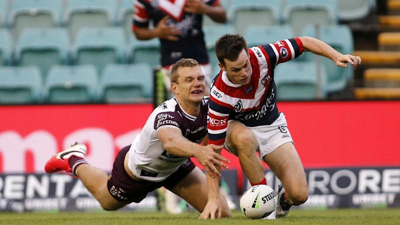 Tom Trbojevic (L) has saved a try and scored one in Manly's 9-8 NRL win over the Sydney Roosters