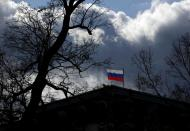 FILE PHOTO: The national flag flutters on top of the Russian embassy in Prague