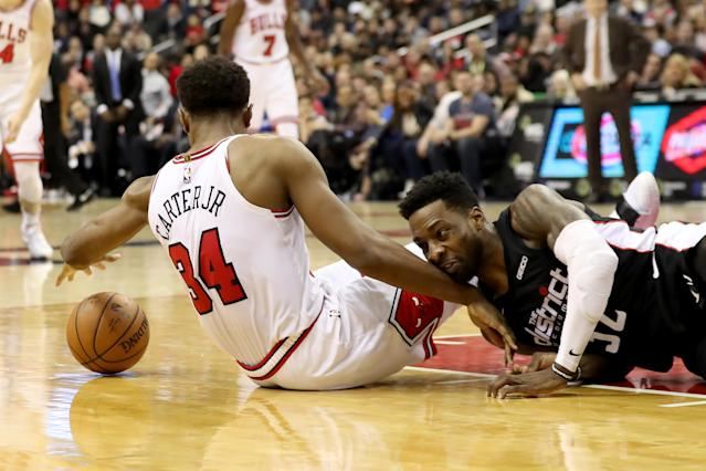 WASHINGTON, DC - DECEMBER 28: Wendell Carter Jr. #34 of the Chicago Bulls and Jeff Green #32 of the Washington Wizards go after a loose ball in the second half at Capital One Arena on December 28, 2018 in Washington, DC. (Photo by Rob Carr/Getty Images)