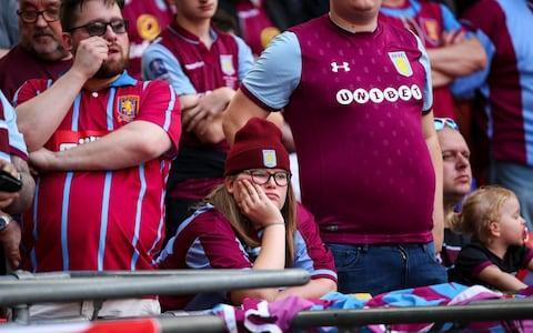 "Aston Villa are under pressure to raise up to £50 million in player sales over the next two transfer windows, it can be revealed. Villa manager Steve Bruce is facing the prospect of key stars including Jack Grealish, James Chester and Jonathan Kodjia being sold as the Championship club battle a financial crisis. Grealish is a target for Tottenham Hotspur, as revealed by Telegraph Sport on June 7, and Mauricio Pochettino is set to test Villa's resolve with an opening offer of £15m. Chelsea and West Ham are also interested in the former England under-21 international, and it seems inevitable the homegrown attacker will be sold after Villa's failure to beat Fulham in last month's play-off final. Despite Grealish's reputation and undoubted ability, it is thought unlikely that Villa will get anywhere near their £40m valuation. Bruce will lose some key players this summer Credit: Getty Images Chester, the Wales international defender, is on the radar of Brighton and Stoke and could fetch up to £10m, while Ivory Coast international Kodjia is likely to be coveted by clubs across Europe. It is understood Villa must bring in a minimum of £40m to ease their financial worries and comply with strict Financial Fair Play regulations for next year. Villa's wage bill has been already lowered to around £45m – from just over £60m – after the departure of skipper John Terry and loan players including Robert Snodgrass, Sam Johnstone, Lewis Grabban and Josh Onomah. But there is still pressure to slash it even further and Villa's technical director Steve Round was given the news in a meeting earlier this week. Villa's wage bill has been already lowered after the departure of skipper John Terry Credit: Getty Images Bruce and Round have accepted the plans and are understood to be keen to stay on and rebuild the club ahead of next season. Some sources have even insisted that the financial picture was expected to be far bleaker. The EFL will meet with Villa officials next week to discuss their plight and how they plan to operate ahead of their third season in the Championship. Dr Tony Xia, the club's beleaguered owner, is reluctant to sell up and is exploring ways of sourcing investment. There was one piece of positive news for Villa on Thursday, however, with defender Alan Hutton agreeing a new 12-month deal despite strong interest from Nottingham Forest. Hutton has taken a significant pay cut to stay on at Villa, estimated to be £15,000 a week, in a welcome boost for Bruce. Hutton said: ""I've definitely found it tough since the Fulham defeat and it hurt me, its taken me time to get to terms with it. ""Everybody's aim was to get promoted last season and we just faltered at the last step. But we have to look forward now and put it behind us. ""We're definitely a Premier League team in my eyes and we will be pushing to do that next season. I'm delighted to stay here and I've got a special bond with the club."""