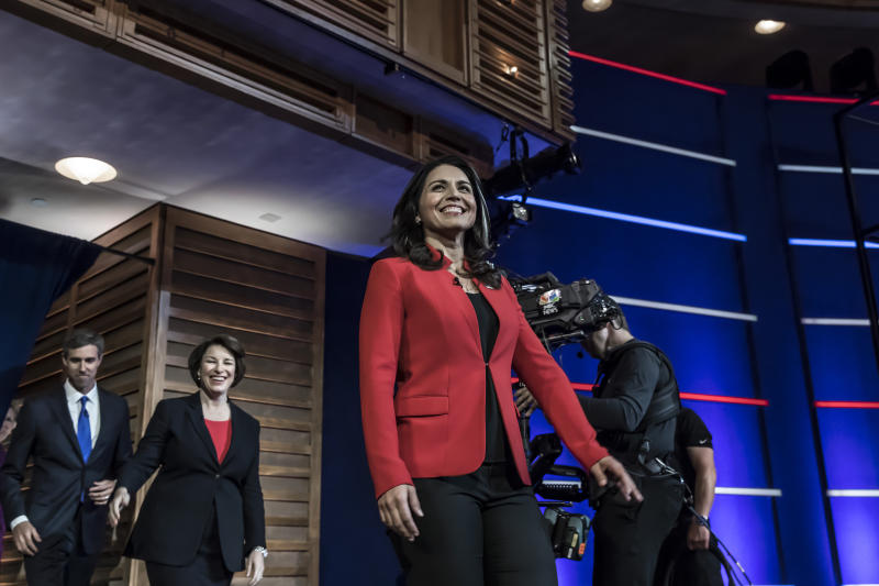 Presidential hopefuls (L-R) Former Texas Rep. Beto O'Rourke, Minnesota Sen. Amy Klobuchar and Hawaii Rep. Tulsi Gabbard arrive onstage for the first night of the Democratic presidential debate on June 26, 2019 in Miami, Florida. | Christopher Morris for TIME