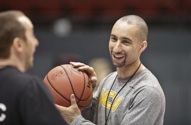 FILE - In this March 20, 2014, file photo, VCU coach Shaka Smart sports a smile during practice for the NCAA men's college basketball tournament in San Diego. Smart is loving life. He's got a nationally regarded team, perhaps its highest-ranked recruiting class and a $25 million practice facility under construction. (AP Photo/Lenny Ignelzi, File)