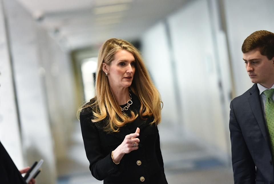 US Senator Kelly Loeffler, R-GA, arrives for the Republican policy luncheon at the Hart Senate Office Building in Washington, DC on March 19, 2020. - Loeffler and Senator Richard Burr  are facing calls to resign after it was reported that the Republican lawmakers sold stock holdings before the COVID-19 epidemic crashed markets.  Both of the senators reportedly attended briefings on the novel coronavirus outbreak and publicly sought to calm nerves as they dumped chunks of their portfolios ahead of market turmoil in March. (Photo by MANDEL NGAN / AFP) (Photo by MANDEL NGAN/AFP via Getty Images)