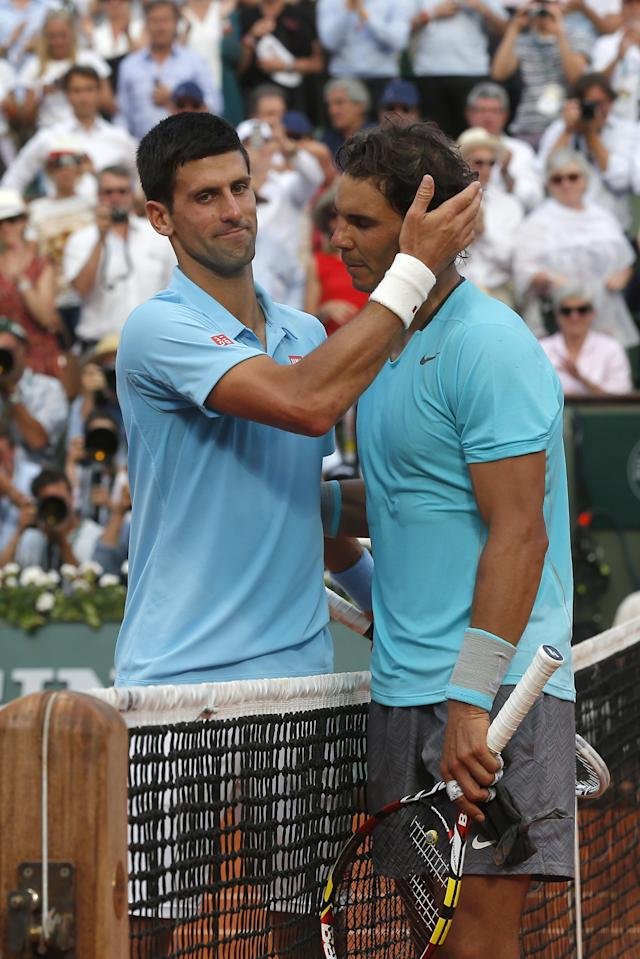 Spain's Rafael Nadal, right, is congratulated by Serbia's Novak Djokovic after winning the final of the French Open tennis tournament at the Roland Garros stadium, in Paris, France, Sunday, June 8, 2014. Nadal won in four sets 3-6, 7-5, 6-2, 6-4. (AP Photo/Michel Euler)