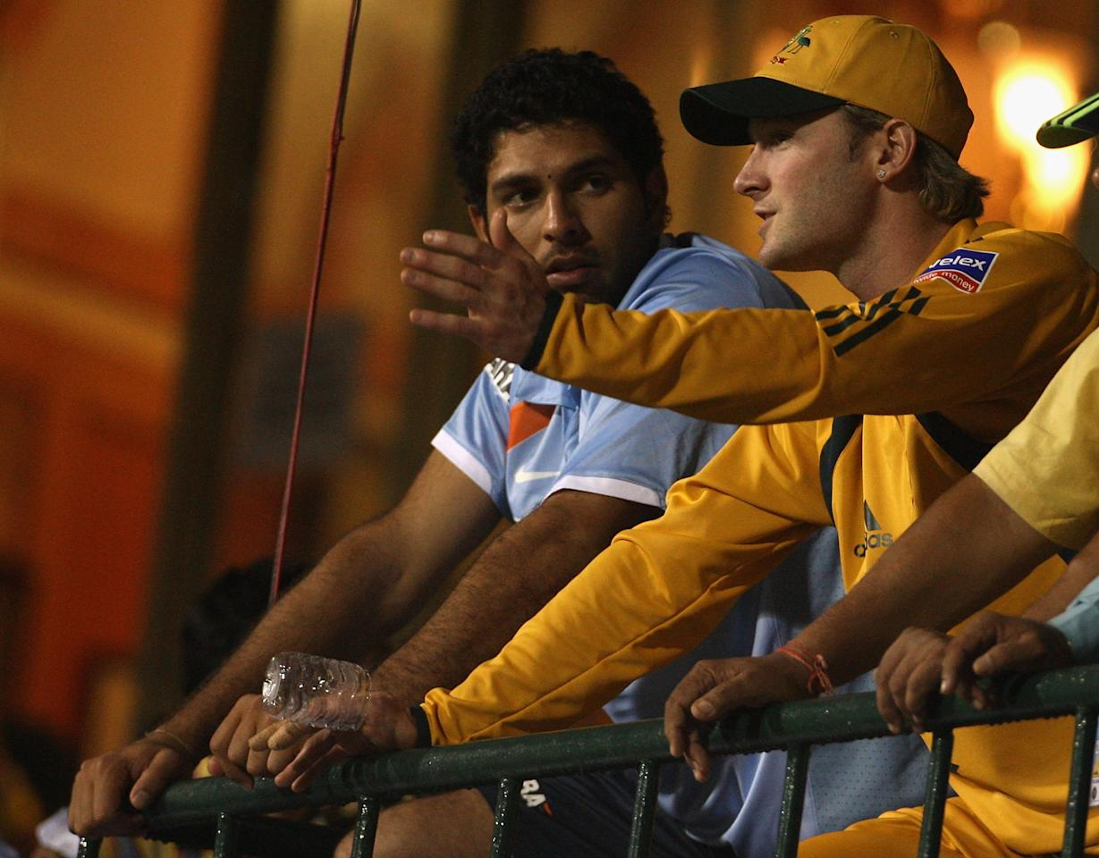 BANGALORE, INDIA - SEPTEMBER 29:  Michael Clarke of Australia and Yuvraj Singh of India chat on the balcony during a rain delay during the first One Day International between India and Australia at M. Chinnaswamy Stadium on September 29, 2007 in Bangalore, India.  (Photo by Hamish Blair/Getty Images)