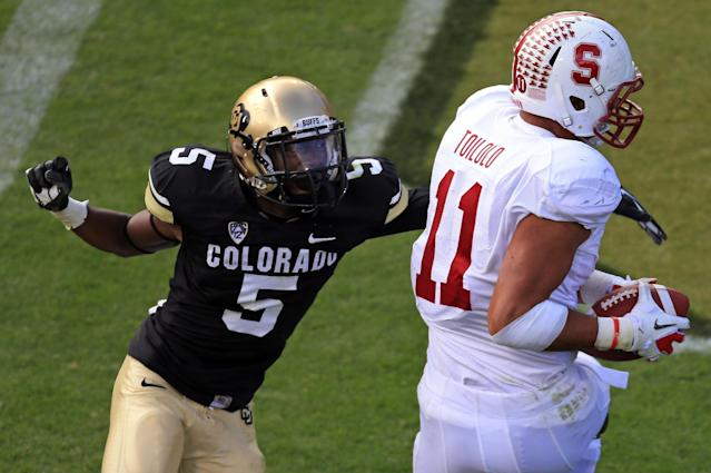 BOULDER, CO - NOVEMBER 03: Tight end Levine Toilolo #11 of the Stanford Cardinals makes a 19 yard touchdown reception against defensive back Yuri Wright #5 of the Colorado Buffaloes in the third quarter at Folsom Field on November 3, 2012 in Boulder, Colorado. The Cardinal defeated the Buffaloes 48-0. (Photo by Doug Pensinger/Getty Images)