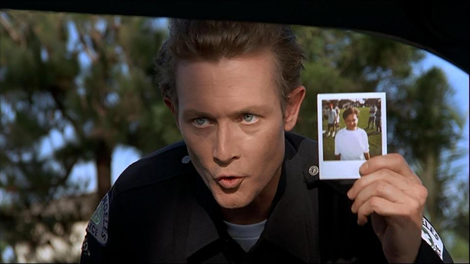"""<p>It's one of the greatest movie cameos of all time, and it makes absolutely no sense, but just go with it. Wayne is pulled over in his Mirth-Mobile and asks the approaching officer if he's done anything wrong. The cop leans into the window and it's none other than Robert Patrick aka 'Terminator 2""""s T-1000, complete with a photo: """"Have you seen this boy?"""" Wayne screams and drives away as fast as he can. Is this, like, Terminator canon? (Credit: Paramount Pictures) </p>"""