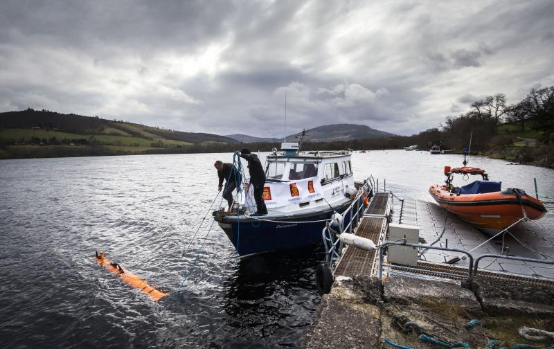Engineer John Haig helps launch the Munin AUV (Autonomous Underwater Vehicle) at Loch Ness, as Nessie hunters were left disappointed when monster remains uncovered at the bottom of the loch turned out to be a 1970s film prop.