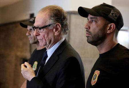 Brazilian Olympic Committee (COB) President Carlos Arthur Nuzman leaves the Federal Police headquarters heading to jail, in Rio de Janeiro, Brazil, October 5, 2017. REUTERS/Bruno Kelly