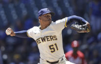Milwaukee Brewers relief pitcher Freddy Peralta throws to the Cincinnati Reds during the first inning of a baseball game Wednesday, June 16, 2021, in Milwaukee. (AP Photo/Jeffrey Phelps)