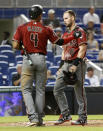 Arizona Diamondbacks' Ketel Marte (4) consoles Chris Owings (16) after Marte scored and Owings was thrown out at home on a single by Deven Marrero during the fifth inning of a baseball game against the Miami Marlins, Wednesday, June 27, 2018, in Miami. (AP Photo/Wilfredo Lee)
