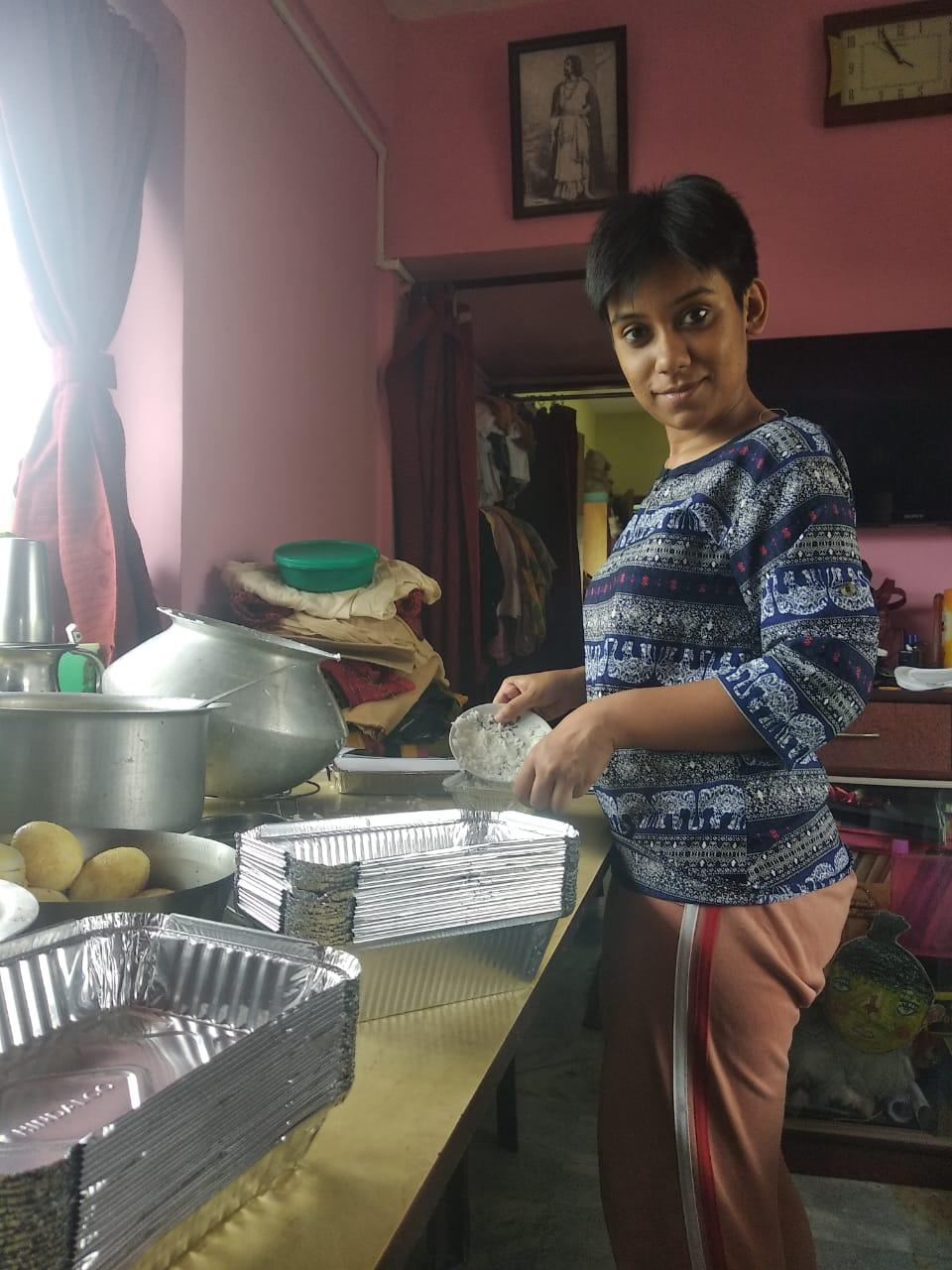 Srabasti Ghosh packing home-cooked meals at her home