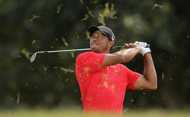 MIAMI, FL - MARCH 11: Tiger Woods plays a shot from the rough on the fifth during the final round of the World Golf Championships-Cadillac Championship on the TPC Blue Monster at Doral Golf Resort And Spa on March 11, 2012 in Miami, Florida. (Photo by Scott Halleran/Getty Images)