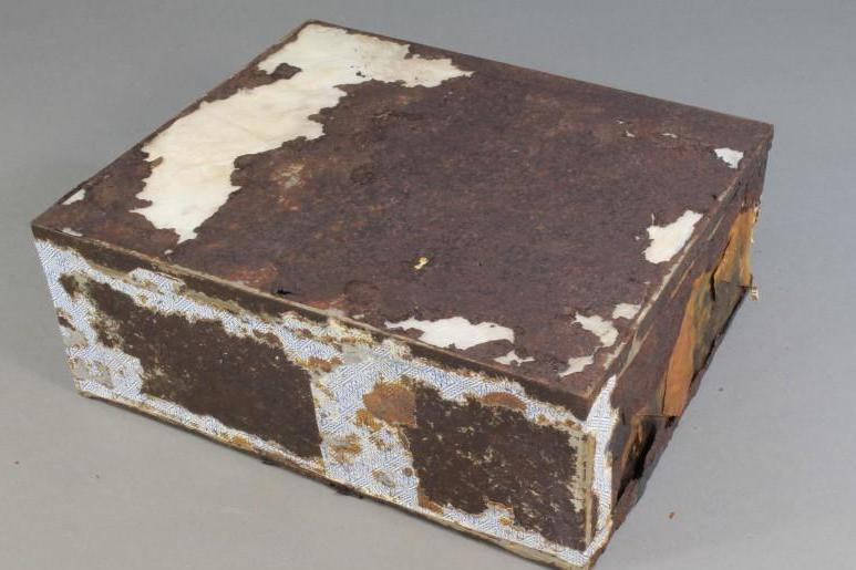 The cake was found in a decaying tin (Antarctic Heritage Trust)