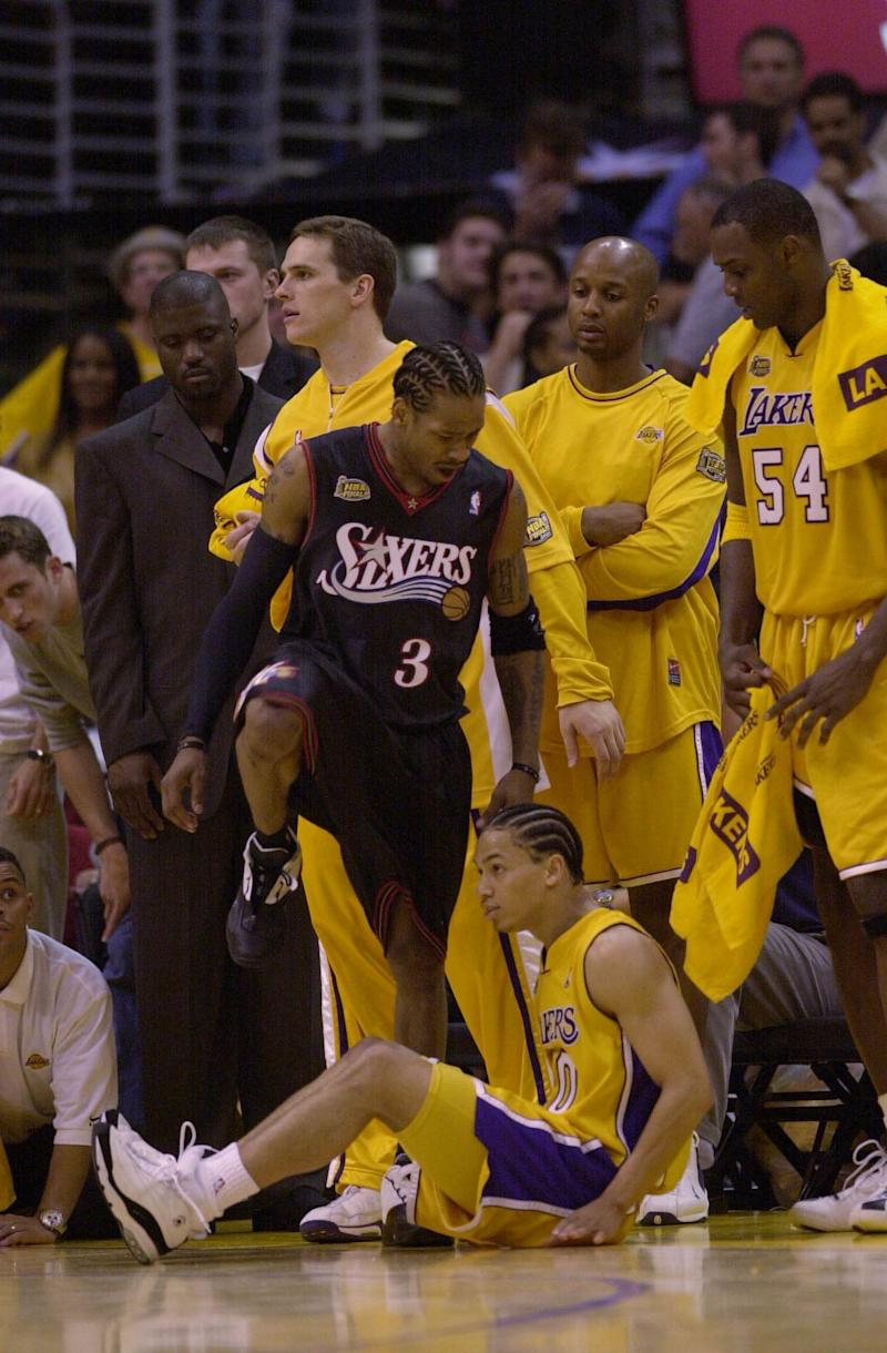 6 Jun 2001: Allen Iverson #3 of the Philadelphia 76ers steps over Tyronn Lue #10 of the Los Angeles Lakers in game one of the NBA Finals at Staples Center in Los Angeles, California. The 76ers won 107-101. DIGITAL IMAGE. Mandatory Credit: Otto Greule/Allsport.