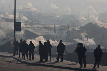 People wait for the bus on a cold polluted day in Ulaanbaatar, Mongolia January 19, 2017. REUTERS/B. Rentsendorj