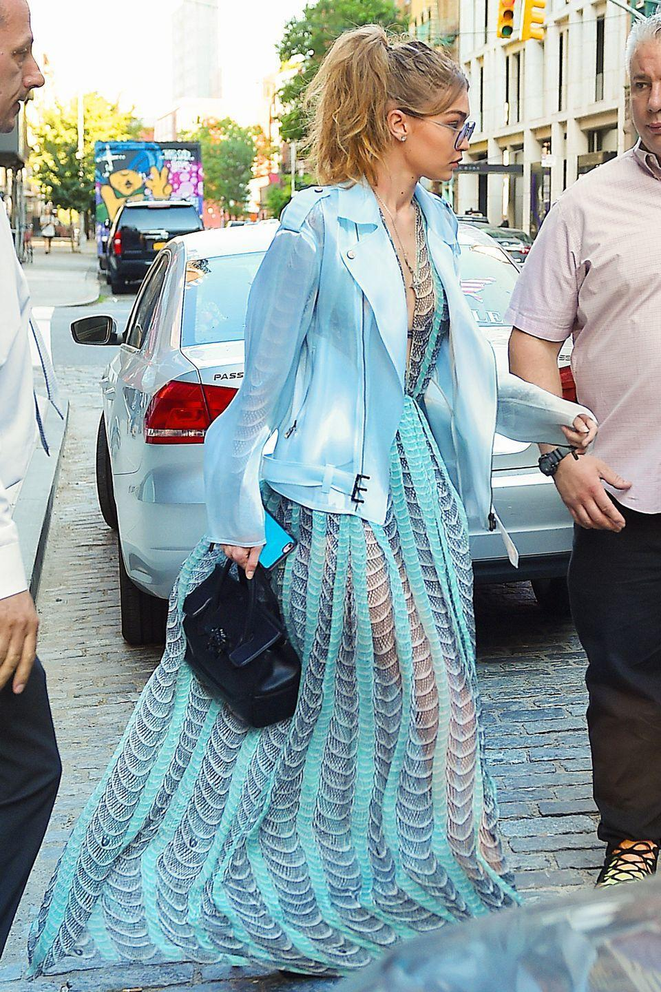 <p>Heading to JFK airport to catch a flight to Toronto, where she's hosting the Much Music Video Awards, in a sheer blue gown and moto-style jacket. </p>