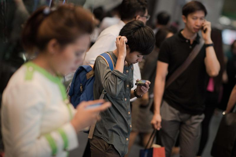 """A 2012 survey by Intel found that in several countries, a majority said they were put off by """"oversharing"""" of pictures and personal information on the internet and smartphones (AFP Photo/Nicolas Asfouri)"""