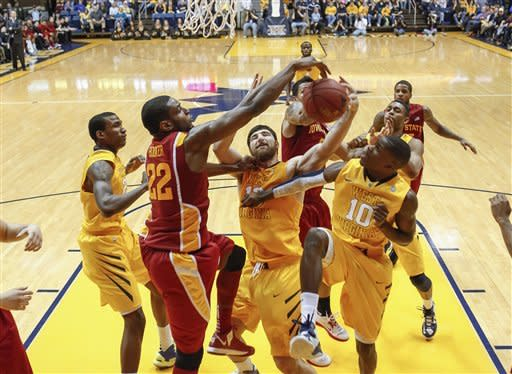 West Virginia's Deniz Kilicli, center, and Iowa State's Anthony Booker (22) fight for a rebound in the second half of an NCAA college basketball game at WVU Coliseum in Morgantown, W.Va., on Saturday, March 9, 2013. Iowa State won 83-74. (AP Photo/David Smith)