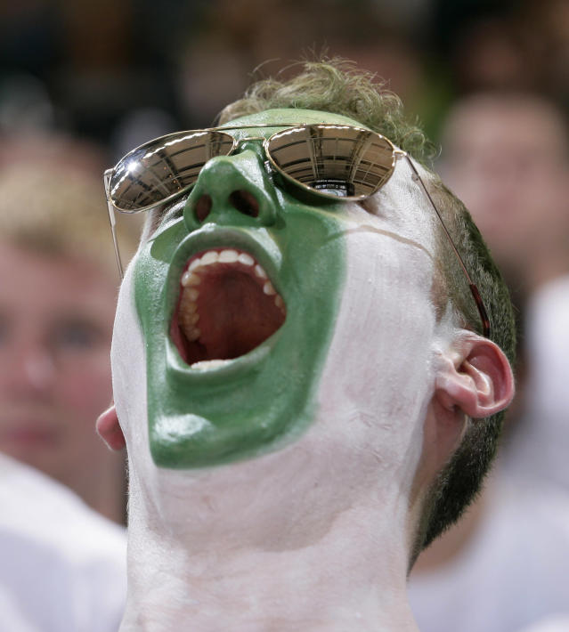 A Michigan State fan cheers before the start of an NCAA college basketball game between Michigan State and North Carolina, Wednesday, Dec. 4, 2013, in East Lansing, Mich. (AP Photo/Al Goldis)