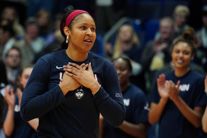 Maya Moore makes a gesture of thanks.
