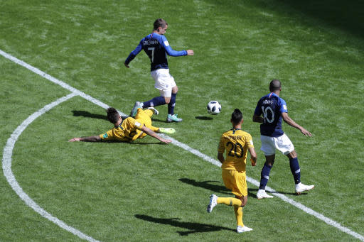 Australia's Joshua Risdon, left, tackles France's Antoine Griezmann, second left conceding a penalty kick for France during the group C match between France and Australia at the 2018 soccer World Cup in the Kazan Arena in Kazan, Russia, Saturday, June 16, 2018. (AP Photo/Hassan Ammar)