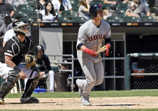 Cleveland Indians' Jake Bauers (10) watches his home run during the fifth inning of a baseball game against the Chicago White Sox, Tuesday, May 14, 2019, in Chicago. (AP Photo/David Banks)