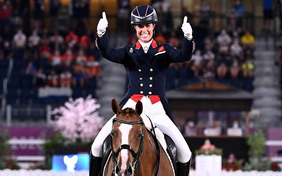 Charlotte Dujardin celebrates her bronze medal to become Britain's most decorated woman Olympian - SHUTTERSTOCK