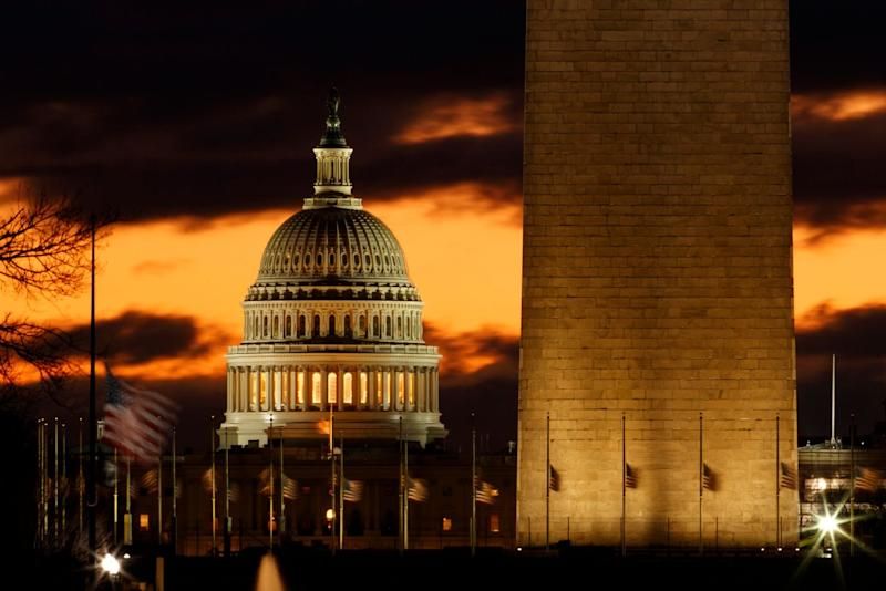The U.S. Capitol dome is seen past the base of the