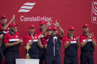"""Team USA captain Steve Stricker holds up a """"W"""" for Wisconsin at the closing ceremony after the Ryder Cup matches at the Whistling Straits Golf Course Sunday, Sept. 26, 2021, in Sheboygan, Wis. (AP Photo/Charlie Neibergall)"""