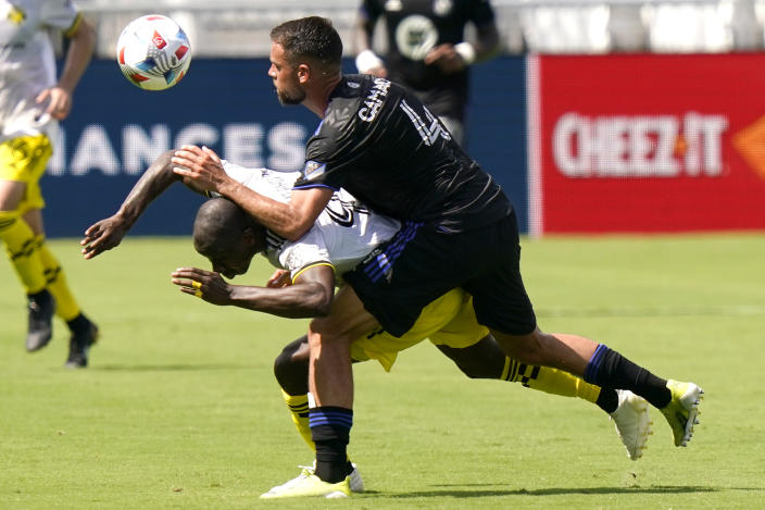 Columbus Crew forward Bradley Wright-Phillips, left, and CF Montréal defender Rudy Camacho (4) battle for the ball during the first half of an MLS soccer match, Saturday, May 1, 2021, in Fort Lauderdale, Fla. (AP Photo/Lynne Sladky)