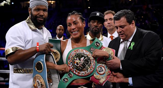 Cecilia Braekhus poses with her belts after defeating Kali Reis in a unanimous decision at StubHub Center on Saturday in Carson, California. (Getty Images)