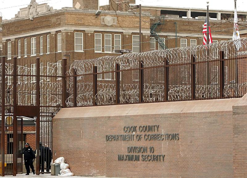 Cook County correctional officers enter the maximum security part of the jail in Chicago on Feb. 12, 2006.